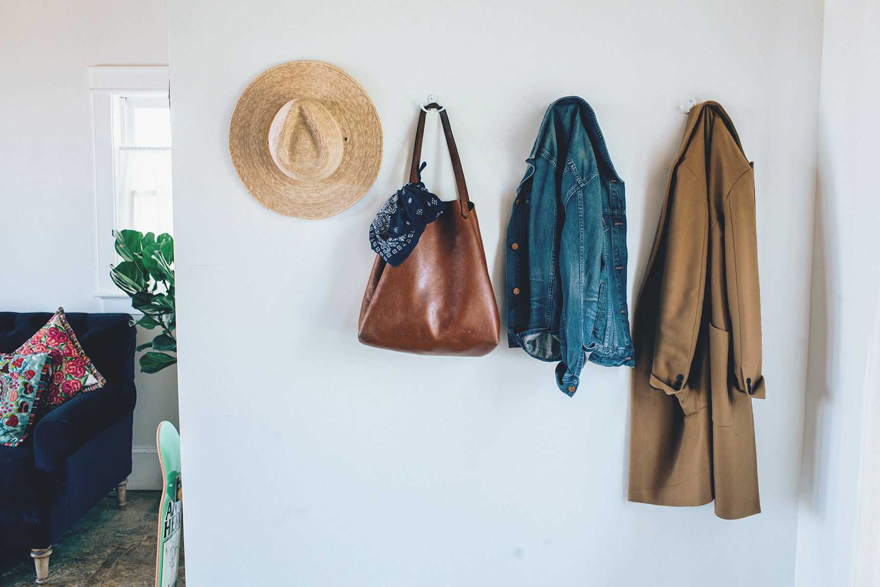 "Pickren calls their hanging storage, ""a total lifesaver."" You can be sure to find the homeowners' hats, jackets, and bags dangling from the obliging pegs."