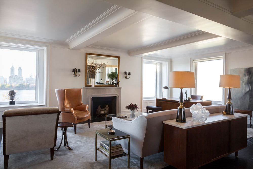 Judicious symmetry and a neutral color scheme predominate in the living room, which overlooks the Central Park reservoir.