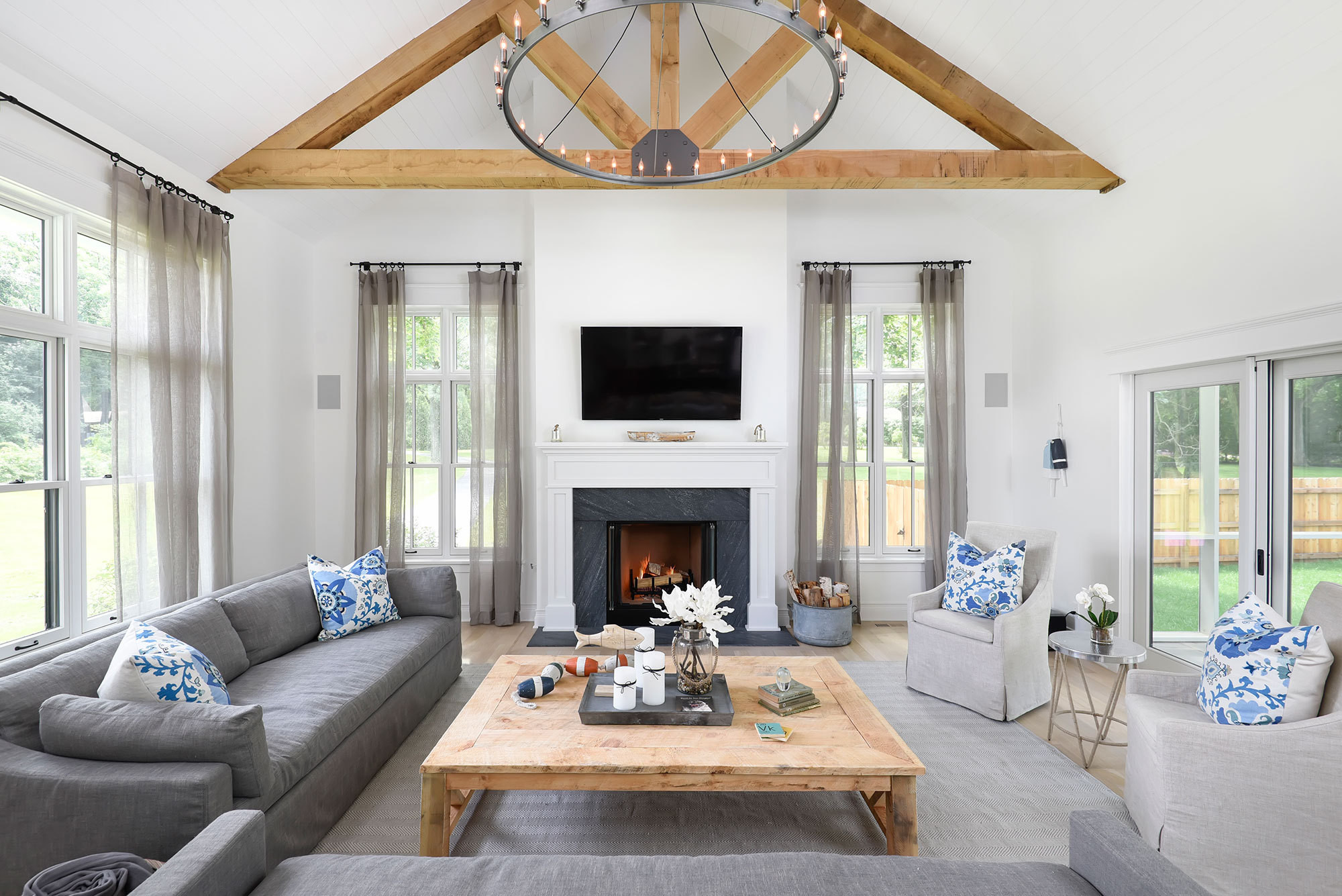 The living room's vaulted ceiling features a rustic touch—rough-sawn white-oak beams with metal brackets.