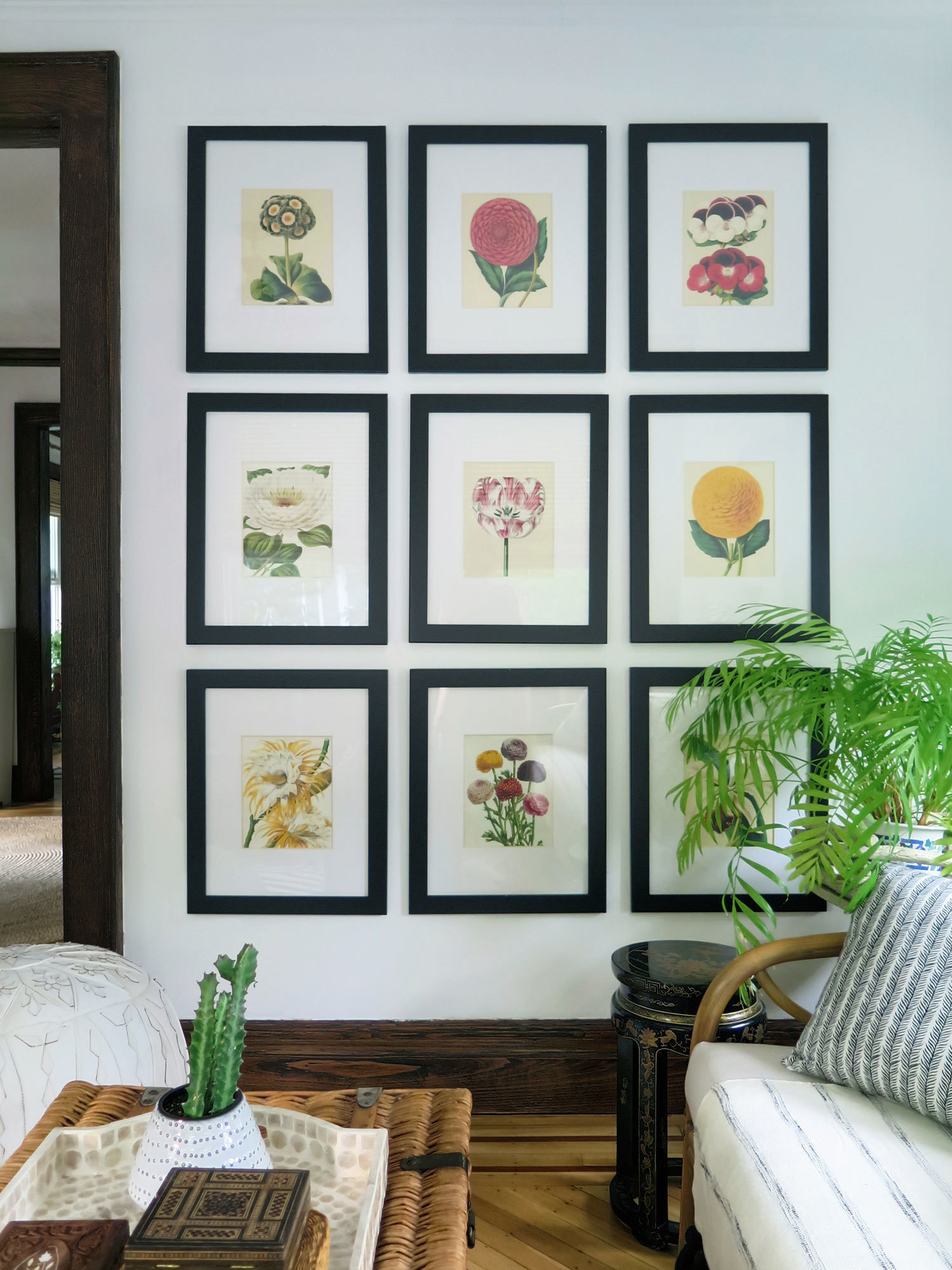 A series of botanical prints in the sun room is one of the few things the couple repurposed from their city apartment.
