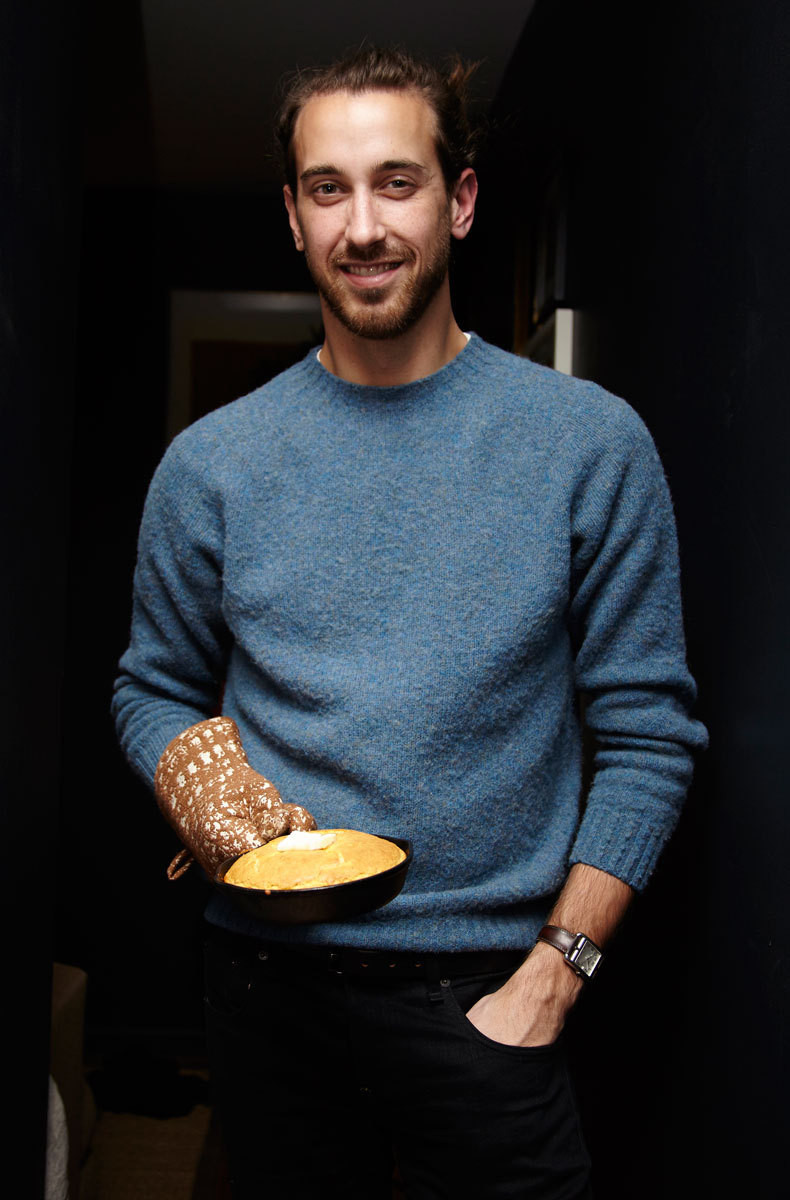 Host Samuel Masters takes a break from the kitchen to showoff his homemade cornbread in a petite cast-iron skillet.