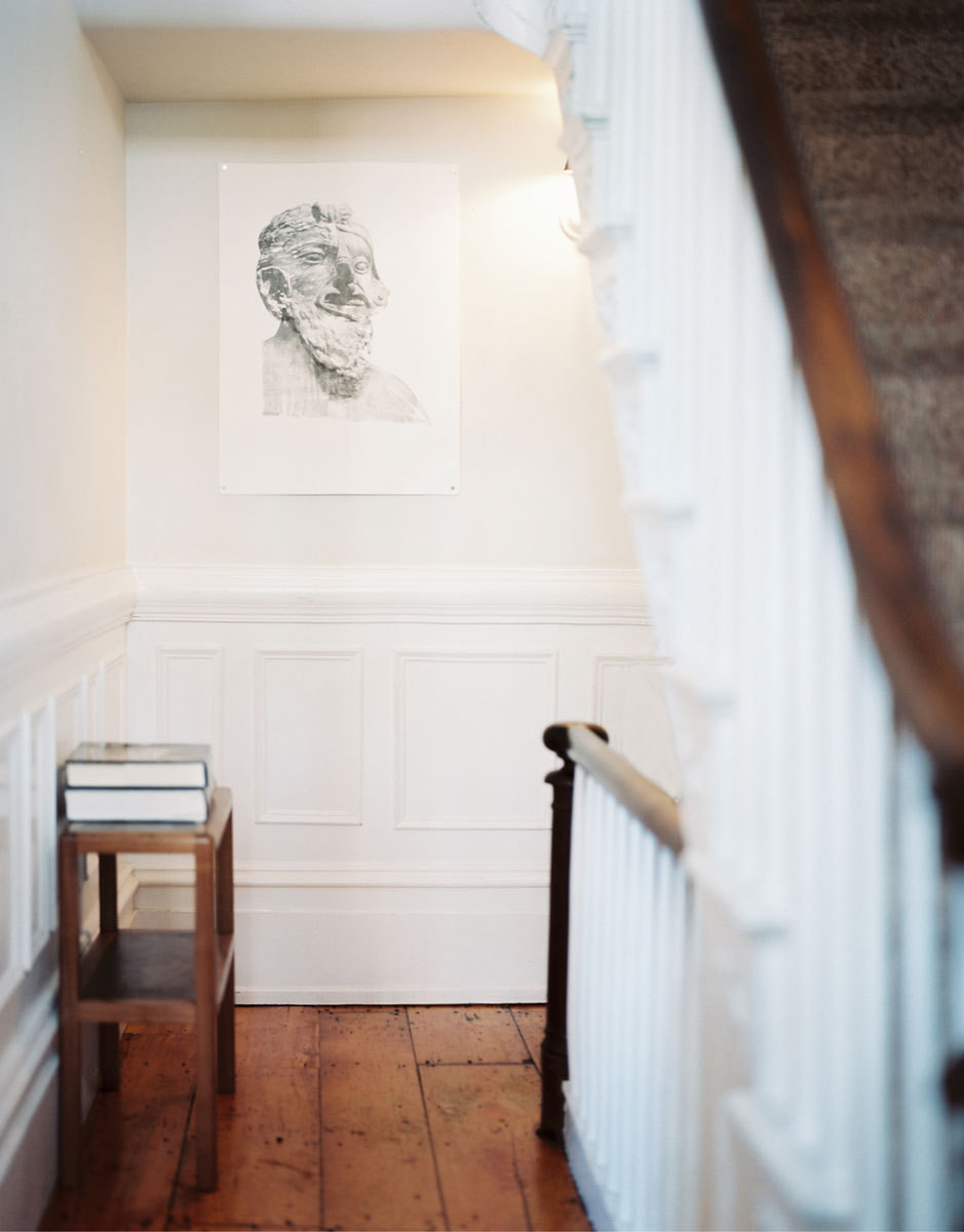 A transfer print by Edmund Galperin adds a sense of history to the entryway of the townhouse.