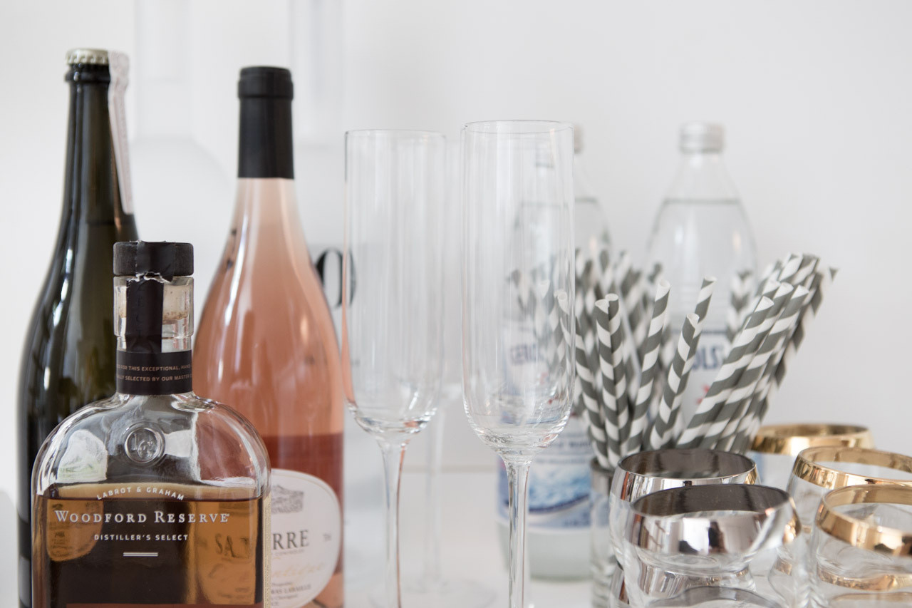 An uncomplicated bar hosts supplies for the simplest two-ingredient cocktail and a bottle of something sparkling.