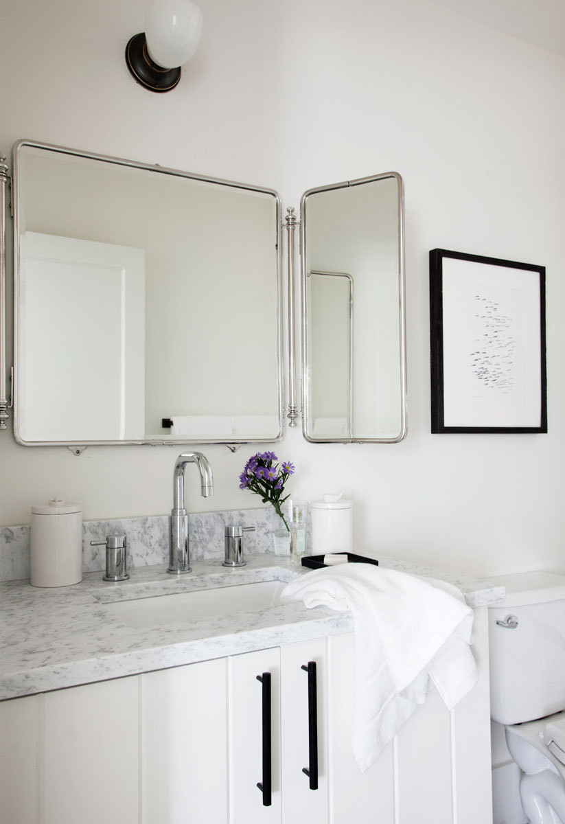 Bathroom vanities and kitchenettes in each of the five guest rooms are topped with Carrara marble counters.