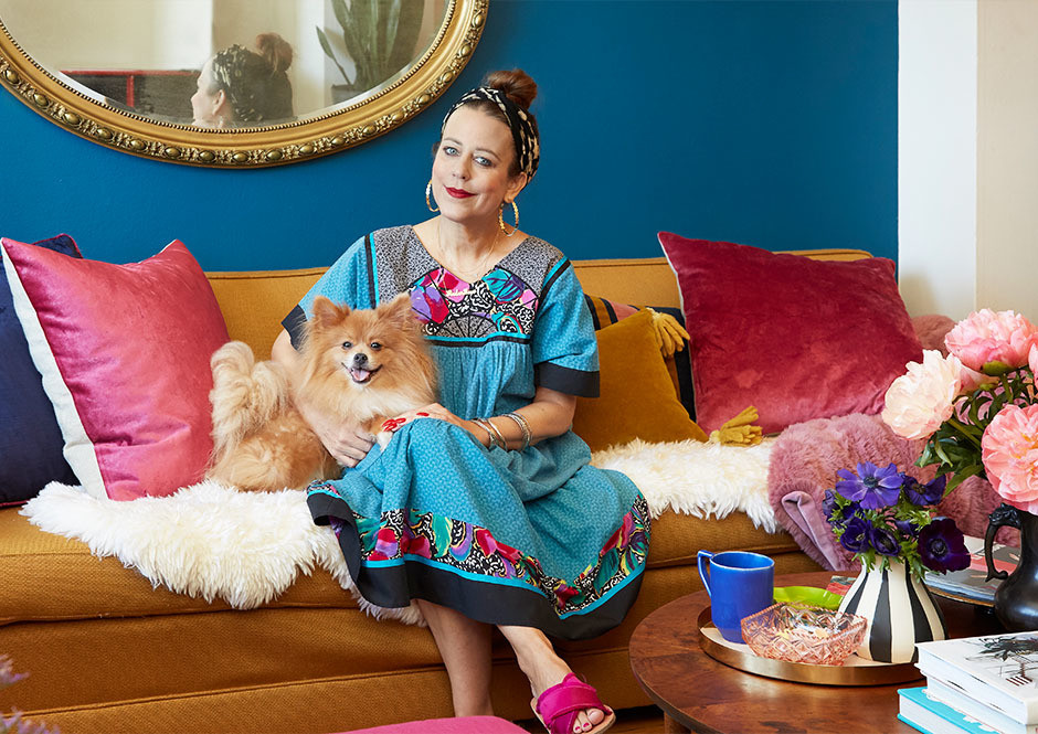"""""""I love the living room, it is definitely my happy place,"""" says the stylist, pictured here with her beloved pomeranian, Booster."""