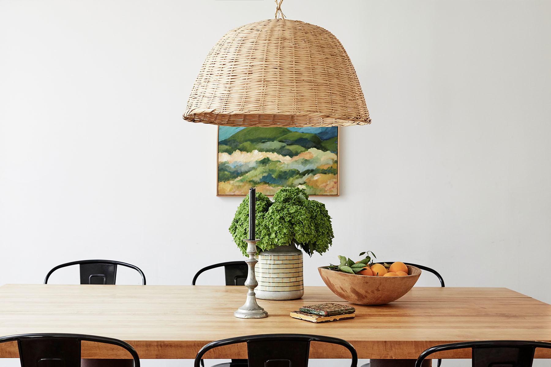 """The dining room table was designed by my father. It's very simple but dramatic,"" says Gran. ""It weighs a ton so it's the one thing in our house that doesn't get moved around all the time."" Custom Warren Gran Dining Table 