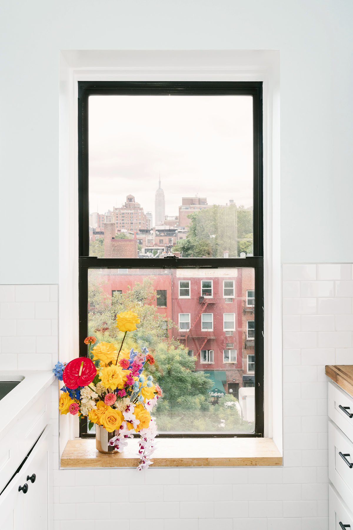 From the kitchen, Li's apartment boasts a view of the iconic Empire State Building. Houzz Vase.