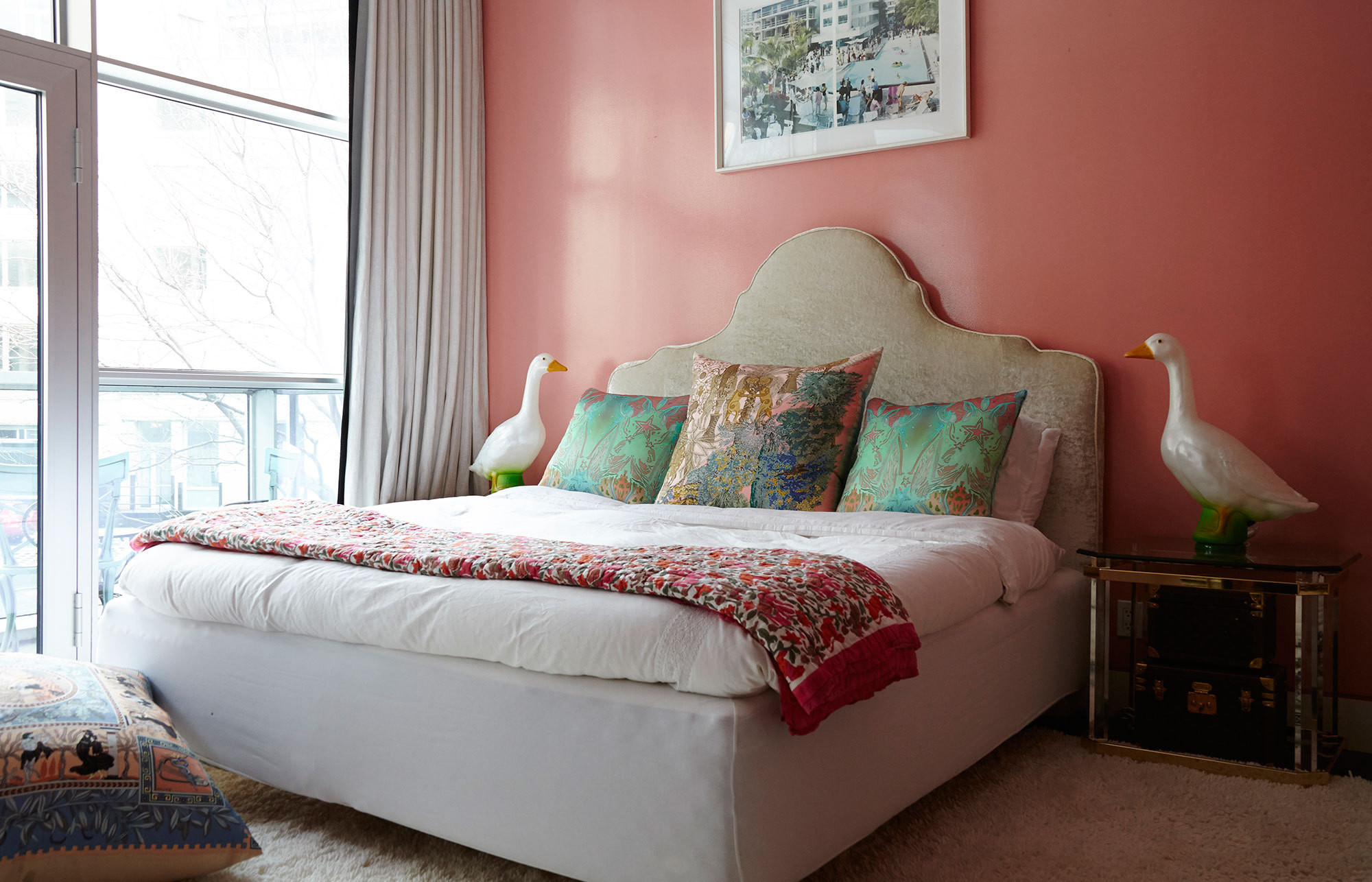 Fine Paints of Europe's Coral Rose creates a cozy, boudoir feel in the master suite. The throw pillows are made from designer scarves, and the geese lamps are vintage.