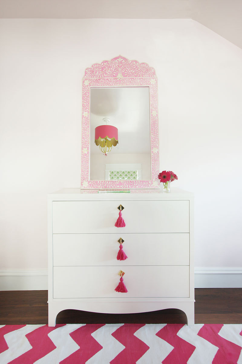 Tassels and a whimsical light fixture grace the girls' room.