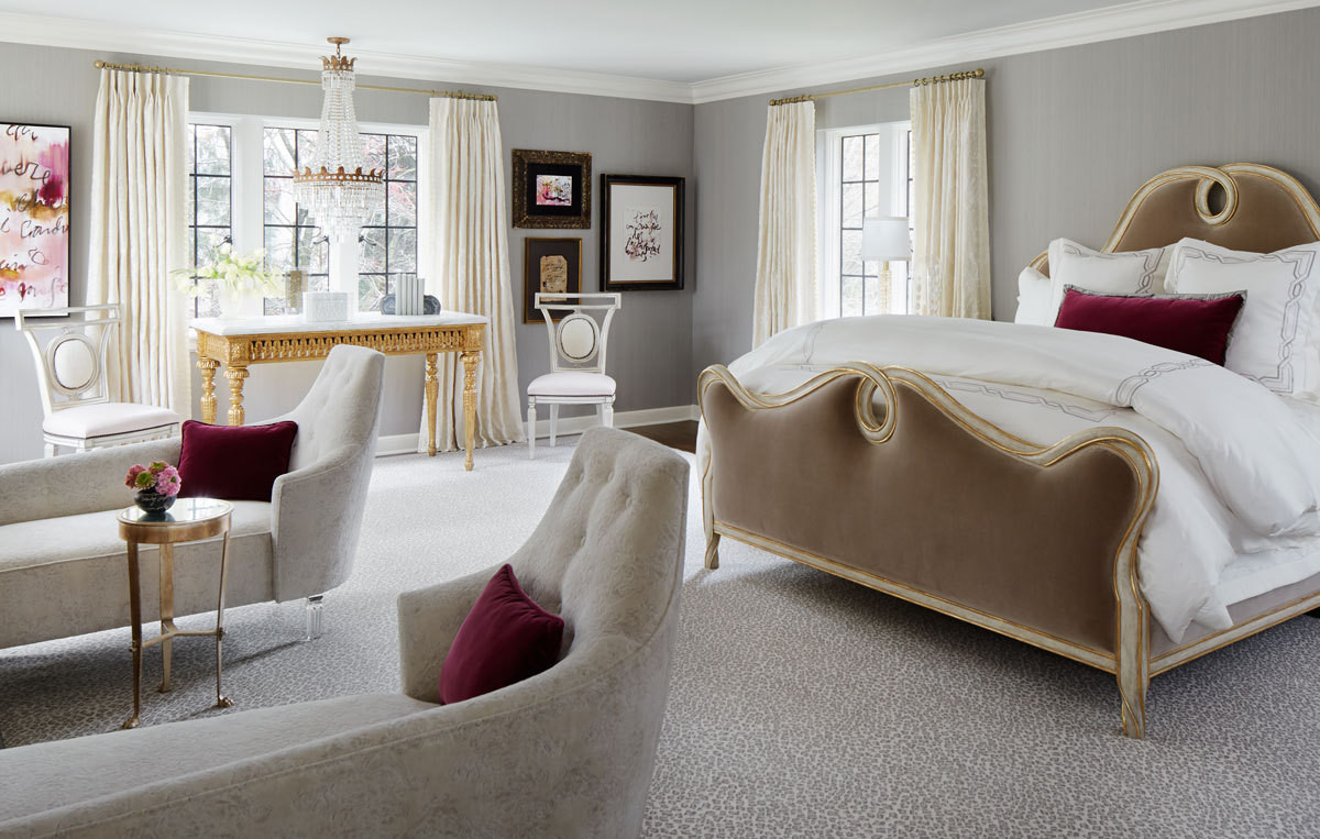 Complete with its own crystal chandelier and custom chaise lounge chairs, designer Kim Scodro created a romantic master bedroom for the Lake Forest Showhouse.Photography by Werner Straube.