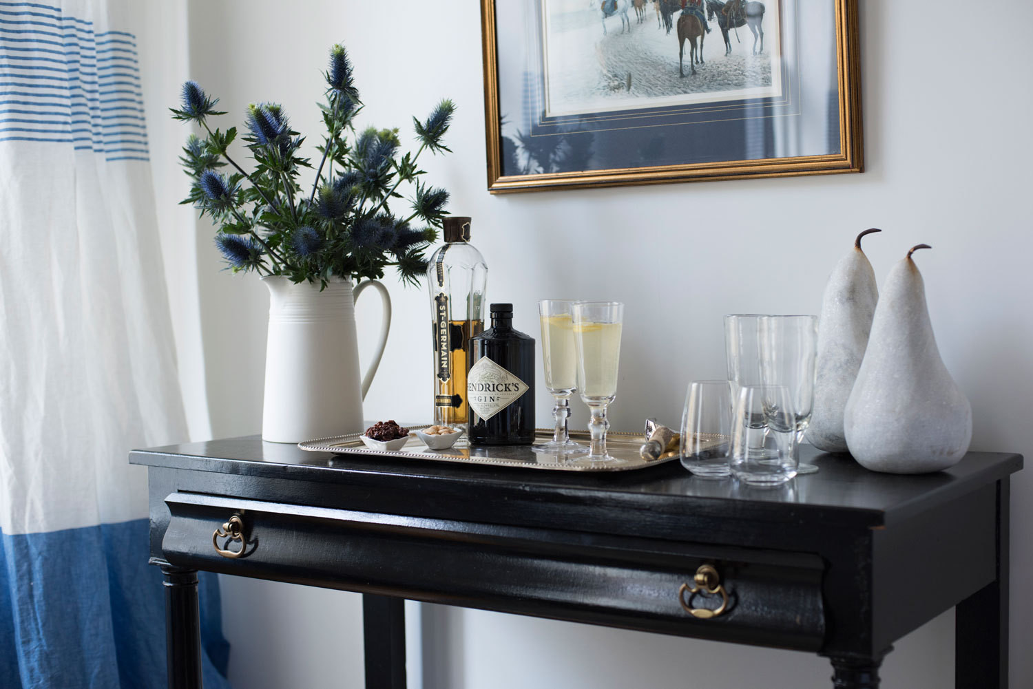 In the Brooklyn apartment Sarah Storms shares with her fiancé, a sideboard doubles as a bar, topped with entertaining essentials from her dream Zola registry. Storms's hair by TéQuan Johnson; makeup by Elyssa Marie Rivera.