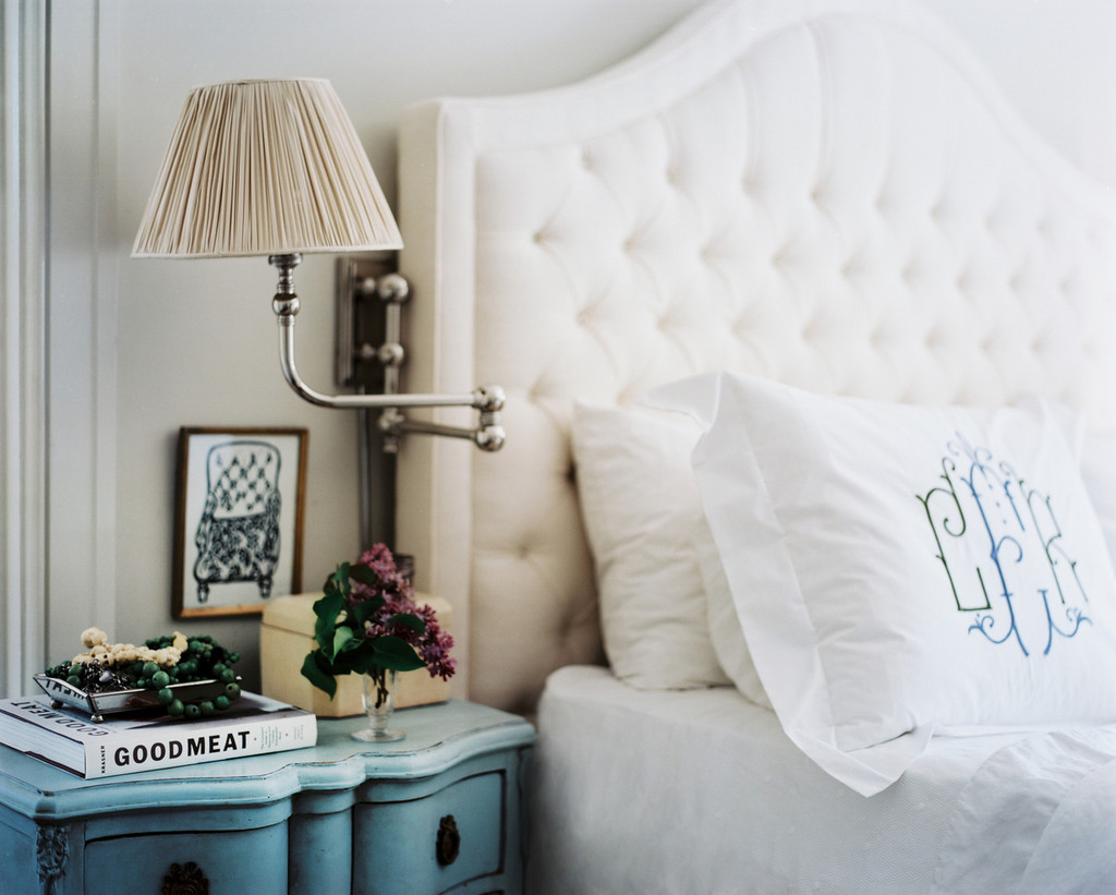 A chic monogram against a tufted headboard | Lonny.com