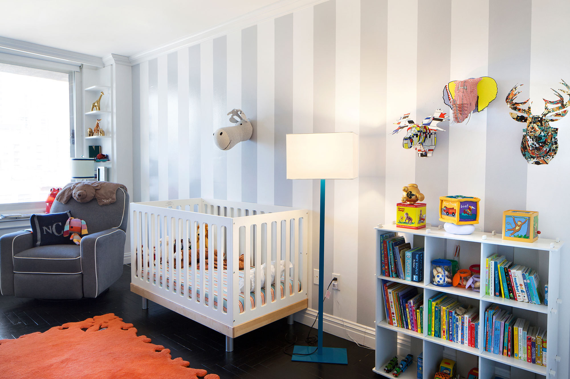 A bright NuLoom rug anchors the nursery, which features lighting and accessories that balance playfulness and sophistication.