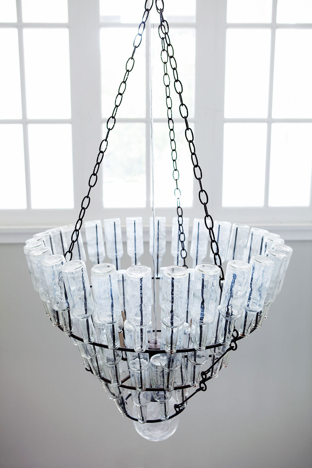 Arteriors' Stedman Chandelier dominates the entryway.
