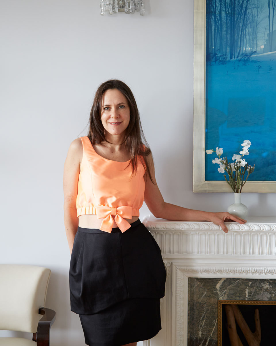 The designer pictured in the living room of the uptown Manhattan apartment she decorated for clients David Keopp and Melissa Thomas and their four children.