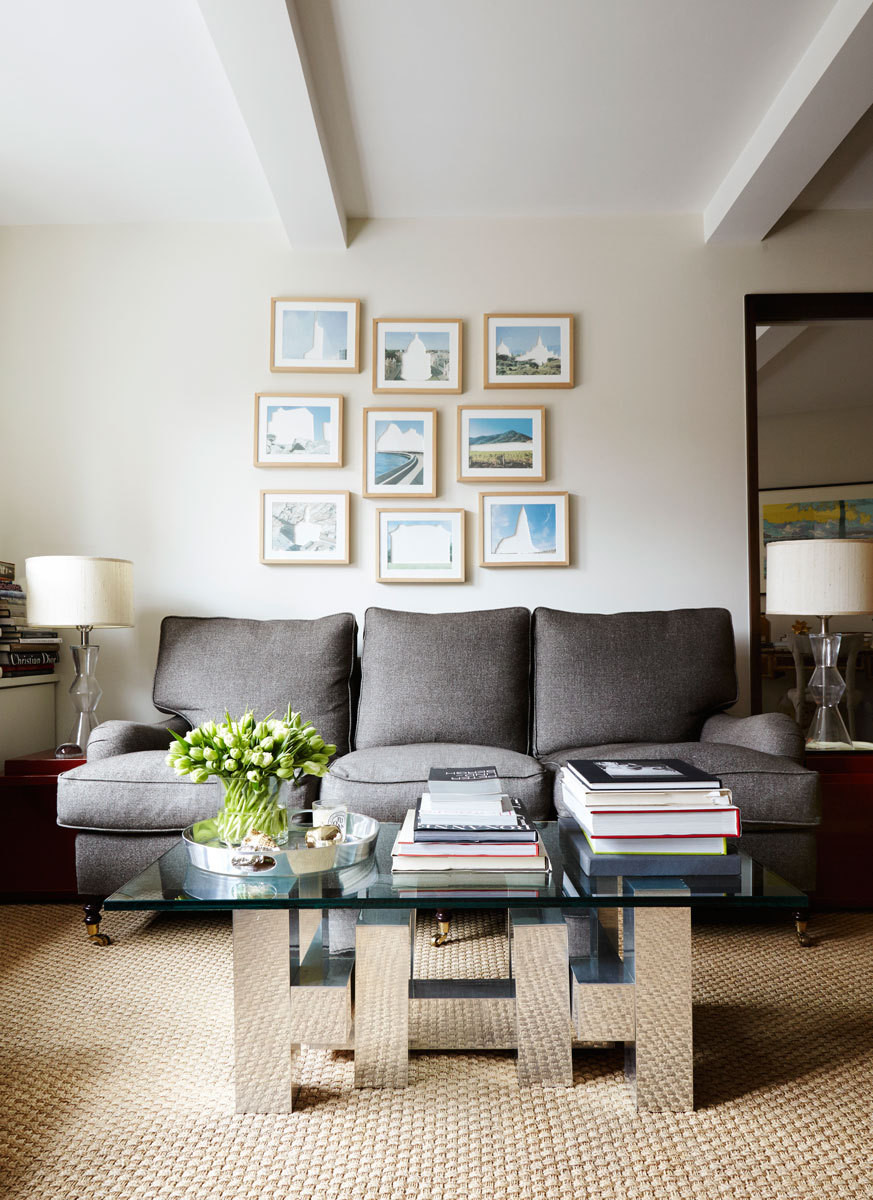 A 20th-century Brutalist coffee table fronts a charcoal-upholstered sofa by George Smith.