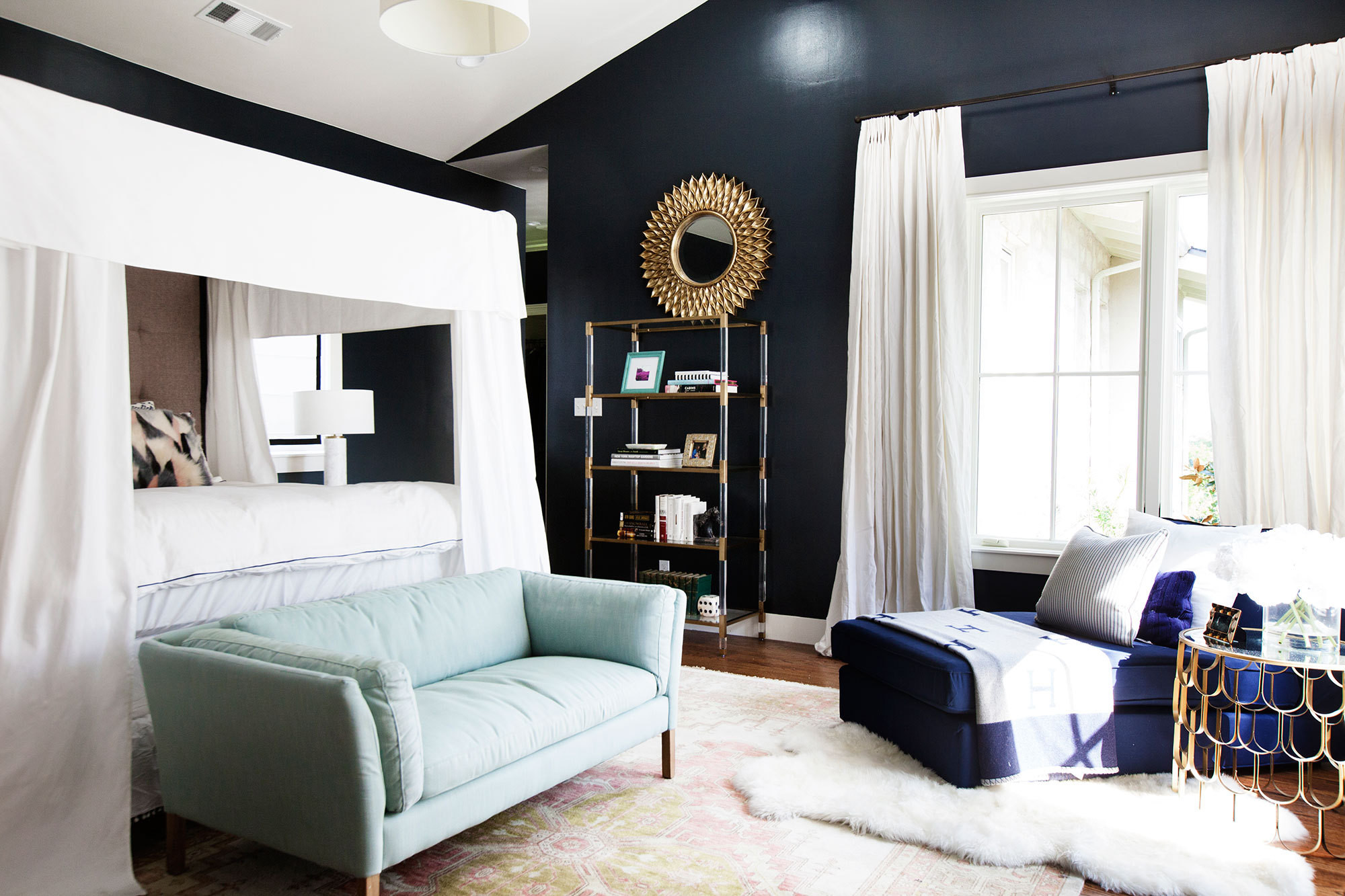 The master bedroom feels like a cozy retreat thanks to a canopy bed and Benjamin Moore's Gravel Grey paint.