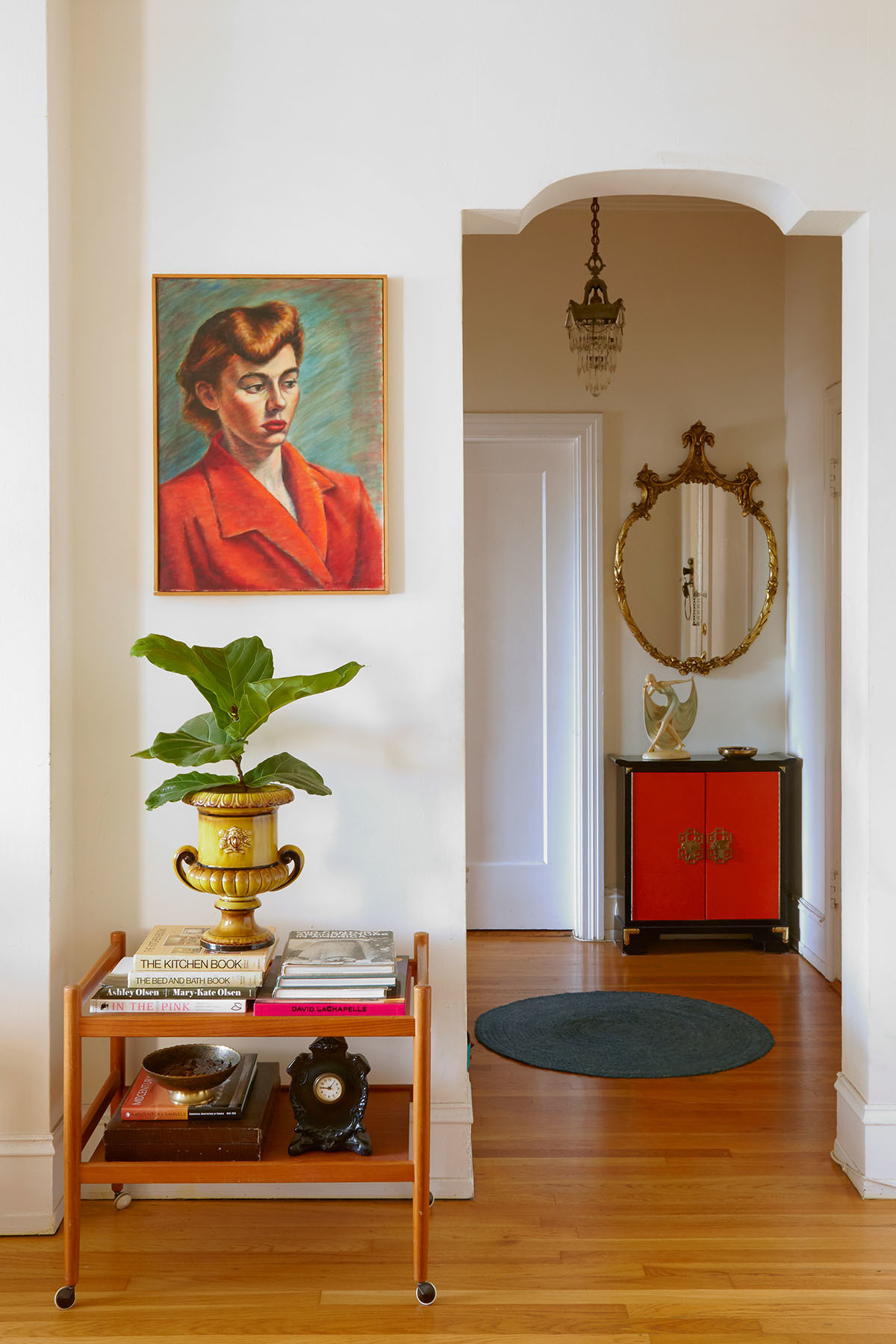 """""""I hunted for many years, back when it was just thrift stores or eBay, and I definitely scored and still have many of those treasures,"""" explains Summer.Past Perfect Vintage Gold Mirror 