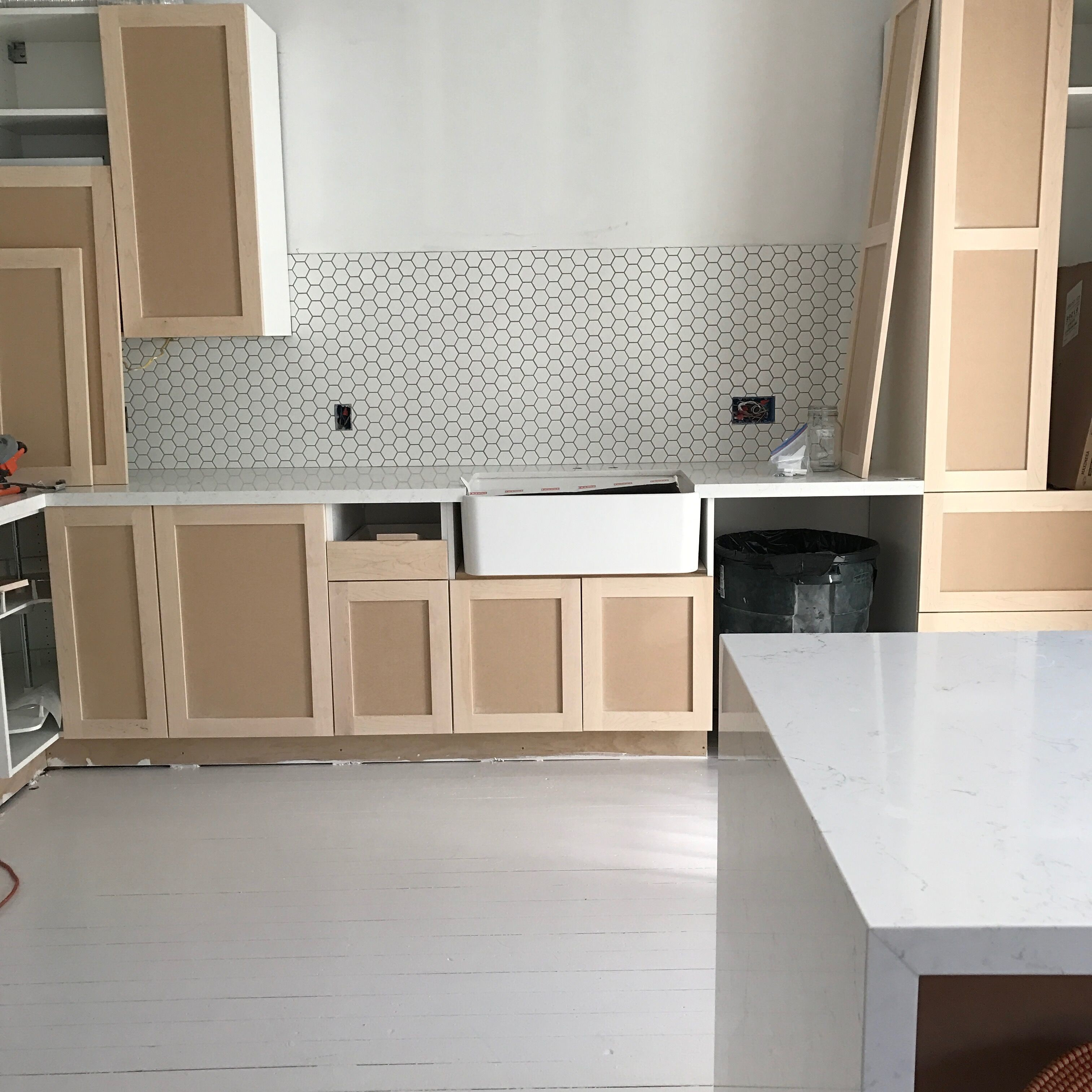 We placed the blank cabinets on to get a sense of the space. We couldn't help it — we were too excited. We soon after removed and painted a minty green.