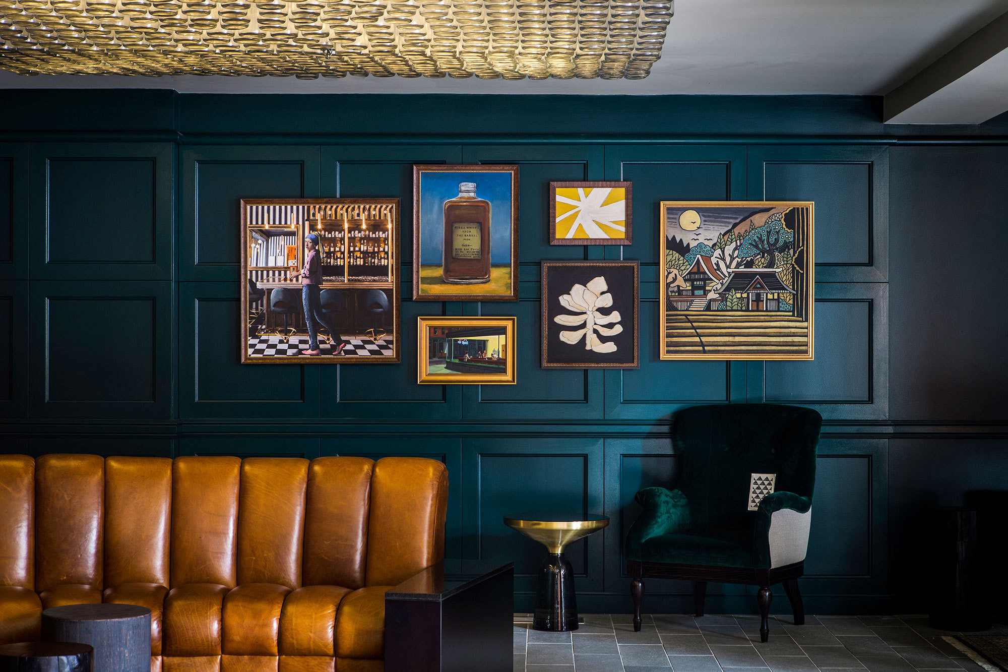 A leather banquette and gallery wall are focal points inthe lobby at The Buchanan, a new hotel by San Francisco designer Nicole Hollis.