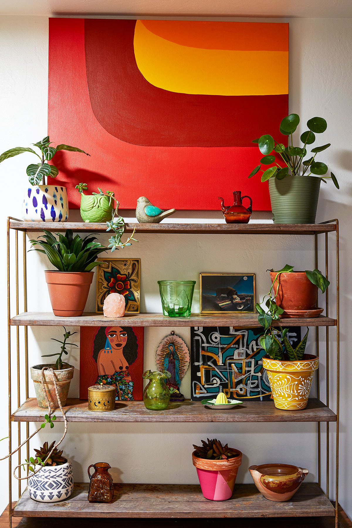 """In Spanish, the term rasquache means ""leftover"" or ""of no value"". This perfectly describes the uniqueness of my home,"" explains Cortes. Vintage Assorted Vases 