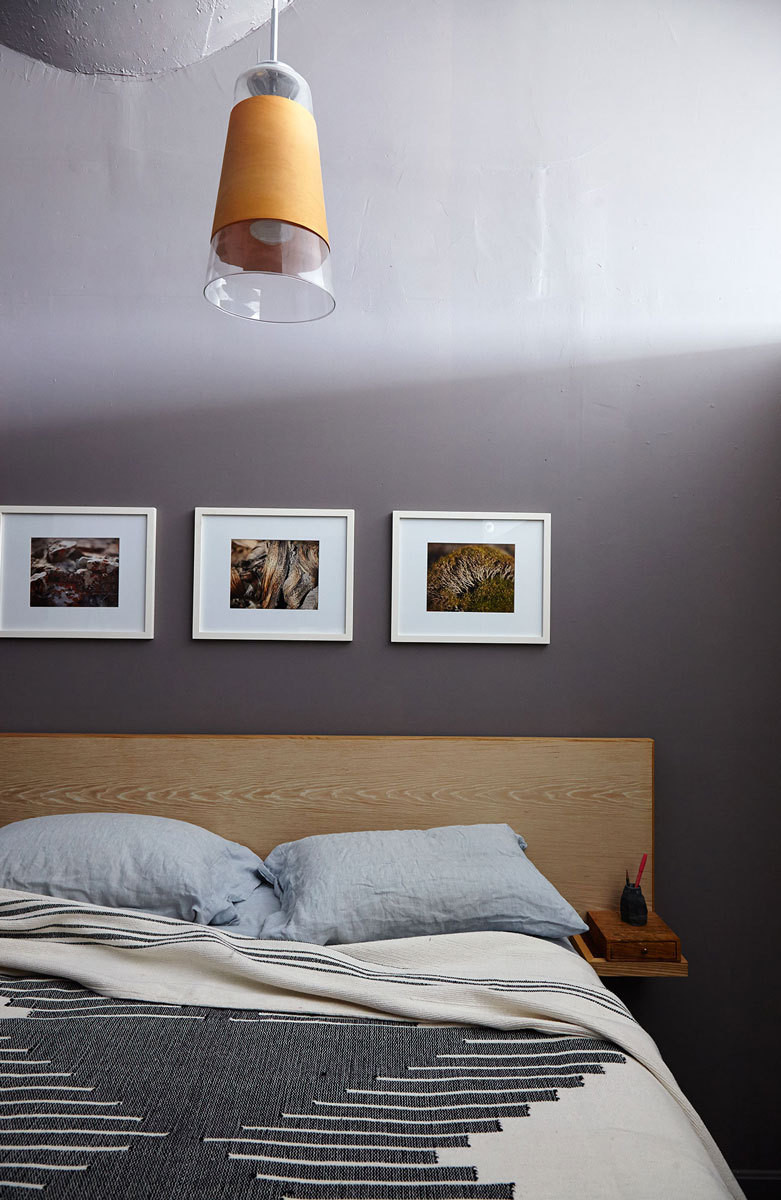 The couple's nature photos hang over their bed.