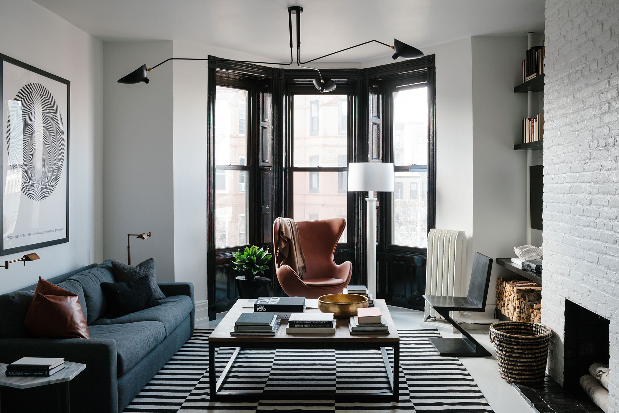 For a Brooklyn brownstone apartment, designer Dan Mazzarini melded historic architecture and modern-masculine furnishings in a strict palette of black and white.