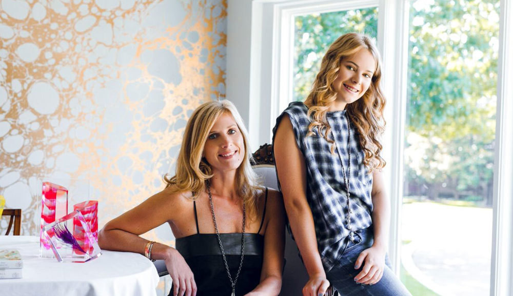 Kim (at left) and Sawyer Bannister in their Dallas dining room.