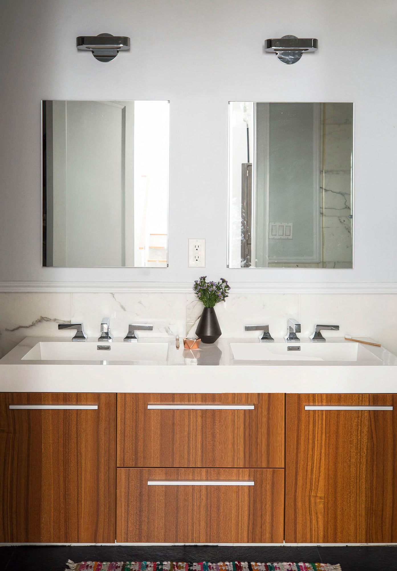 Other design features include a marble backsplash, wooden cabinetry, and sleek nickel hardware.