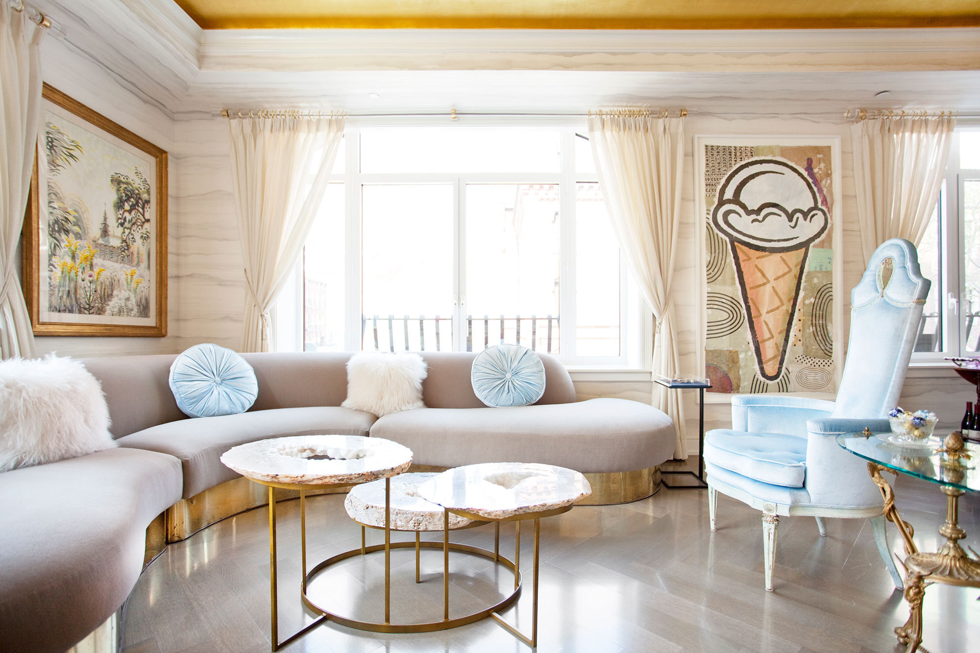 Gold-leaf ceilings in the living room preside over a Milo Baughman sectional, Dorothy Draper chairs, and a contemporary ice-cream cone painting by Donald Baechler.
