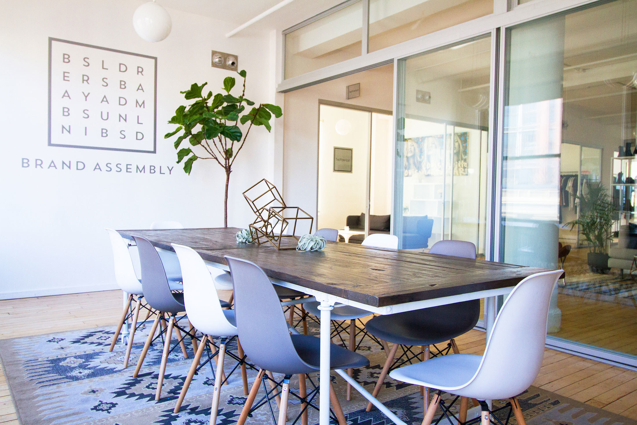 The bright and airy shared conference room at Brand Assembly.