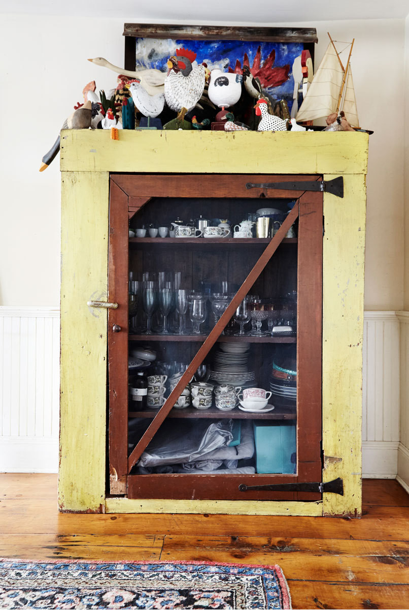 Tabletop items are kept in a rustic cabinet.