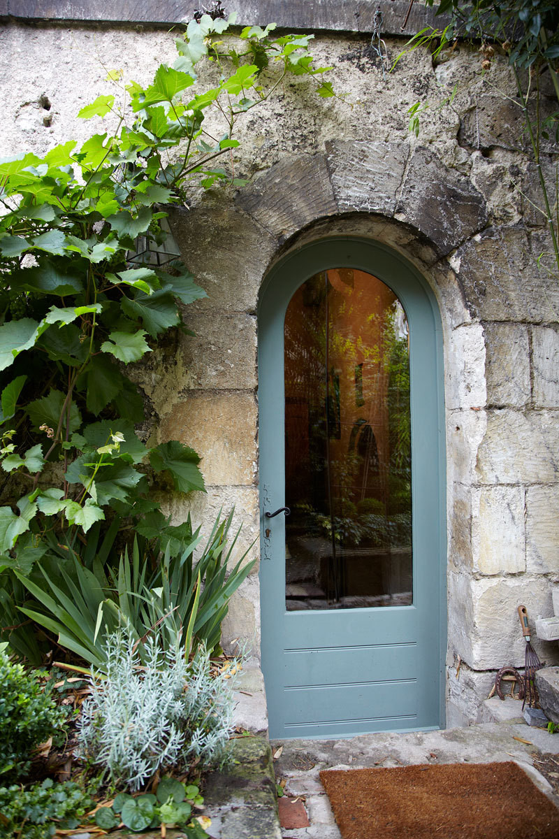 The house has a second entrance that leads to a foyer just beyond the house's stunning garden.