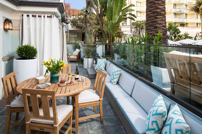 private patio, with its crisp teak furniture and upholstered banquette ...