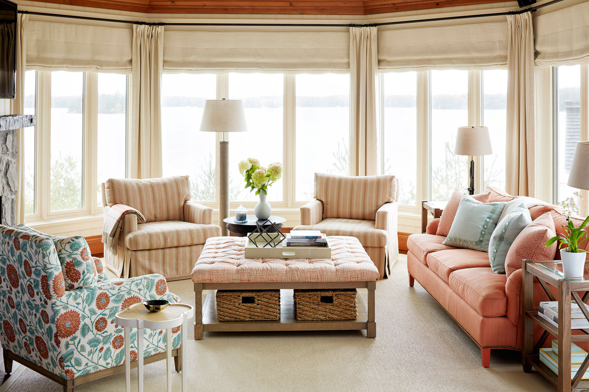 In the family room, overlooking Lake Joseph, upholstered furnishings and understated hues create a mood of ease and comfort.