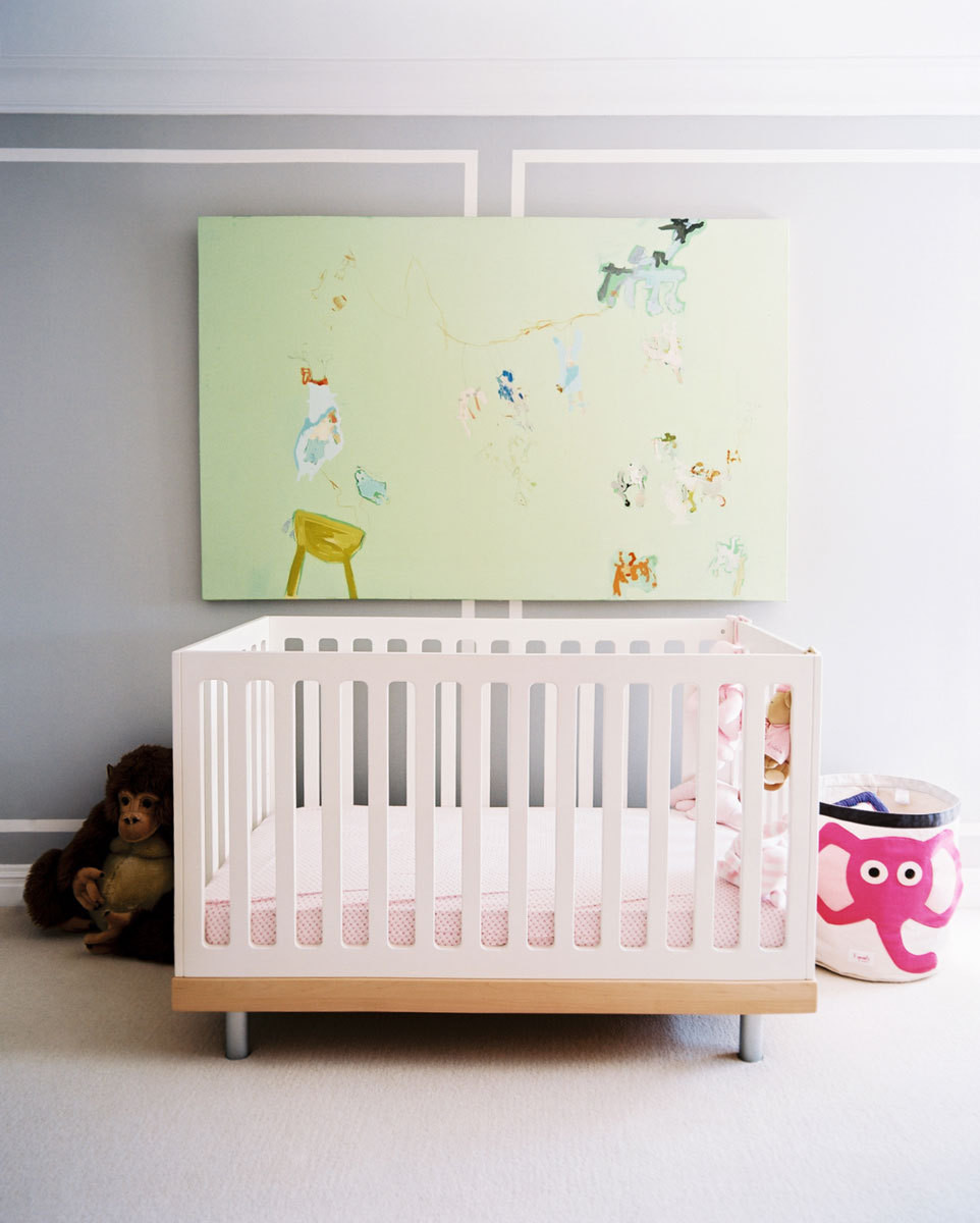 The nursery is as fashion forward as it is kid-friendly. Wall-to-wall carpeting ensures a safe play surface, and vibrant, modern art supplies visual stimulation.