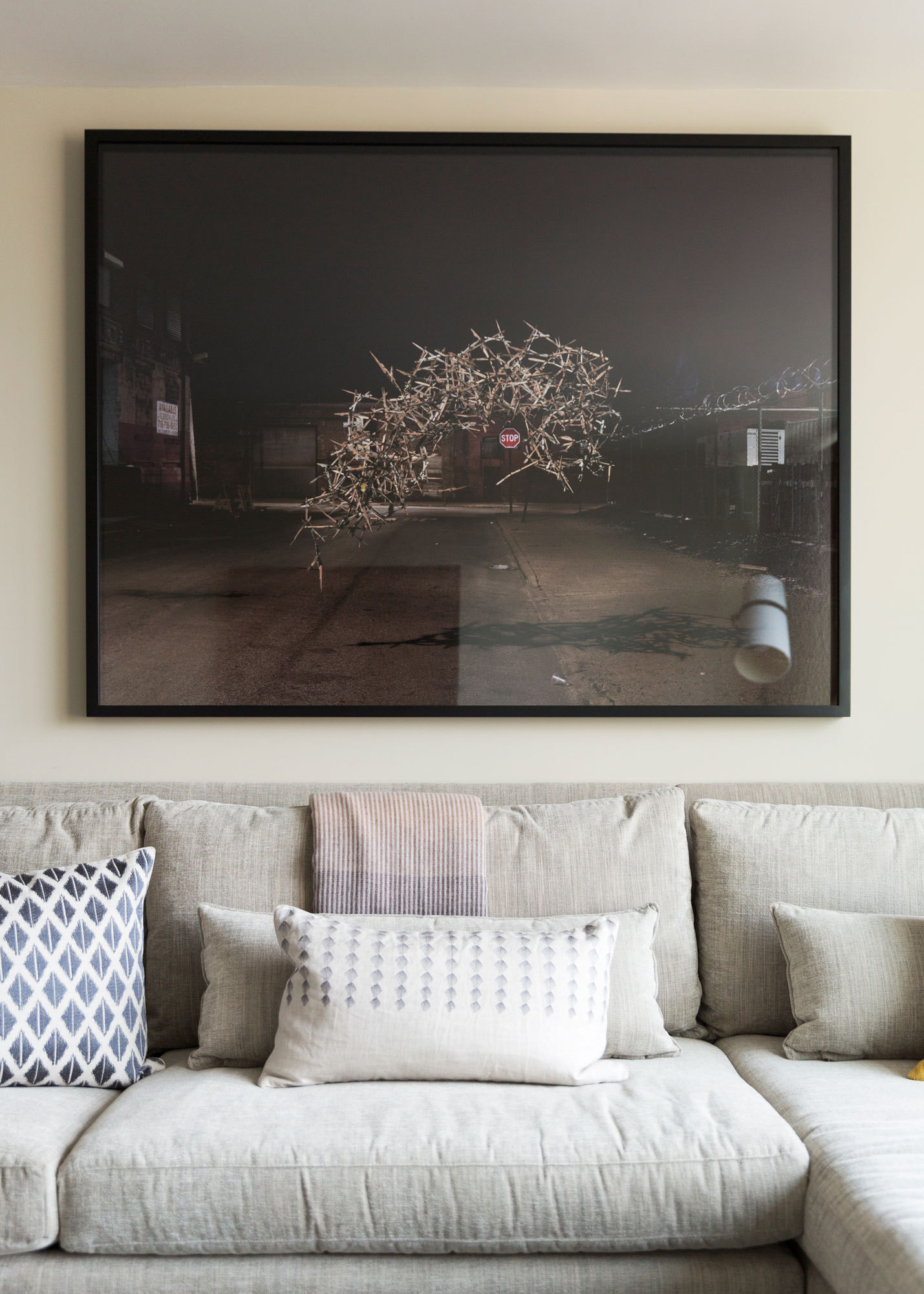 A moody, large-scale image above the sectional.