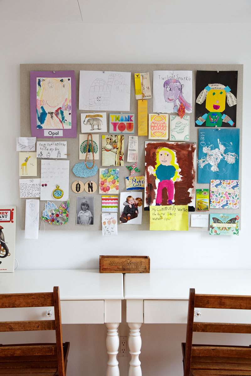 Opal and Ned get a dedicated place in their bedroom to display their own artwork and mementos.
