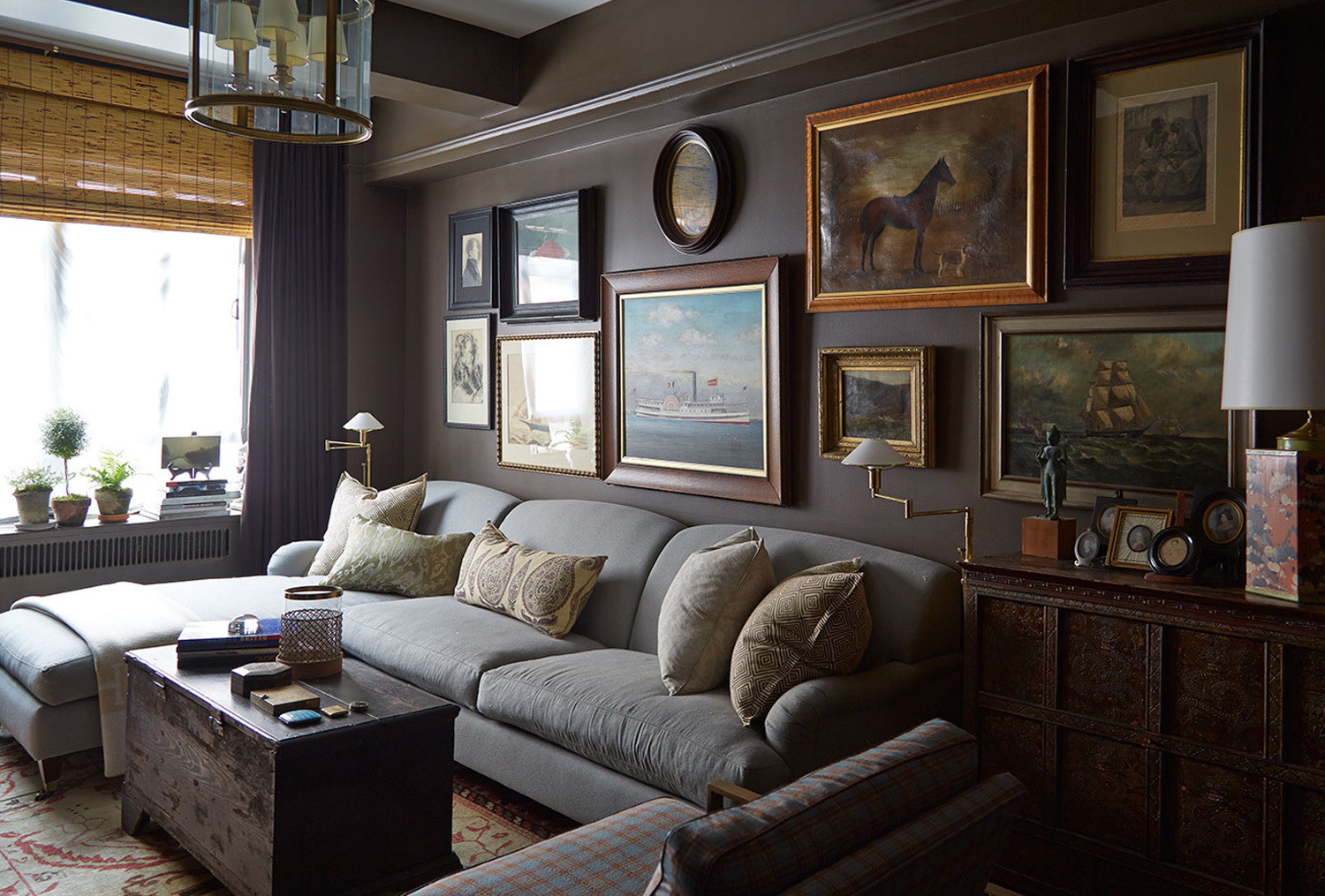 In the study, the Beares' collection of artlooks polished yet unstuffy when hung in an informal arrangement.