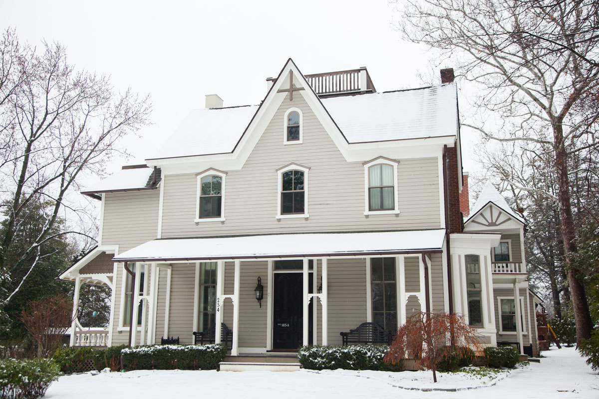 Shot in winter, the home's traditional exterior provides little clue to the mix of periods and styles within.