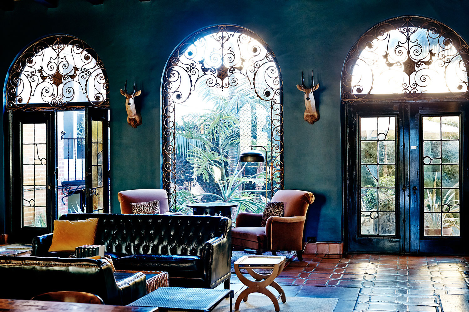 In the lobby a trio of imposing arched windows feature blown glass and wrought