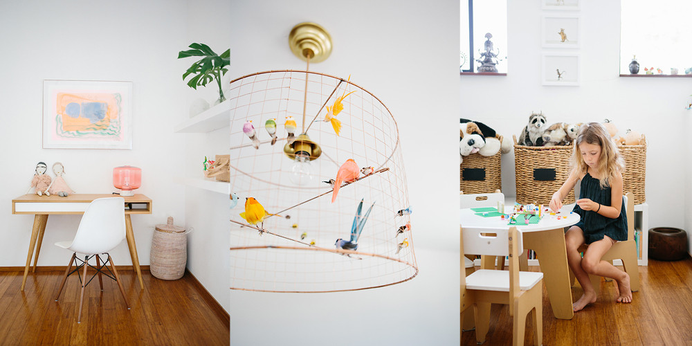 Whimsical details swirl throughout the girl's bedrooms and play area, from the colorful art above Elle's desk to the birdcage light fixture in the playroom.