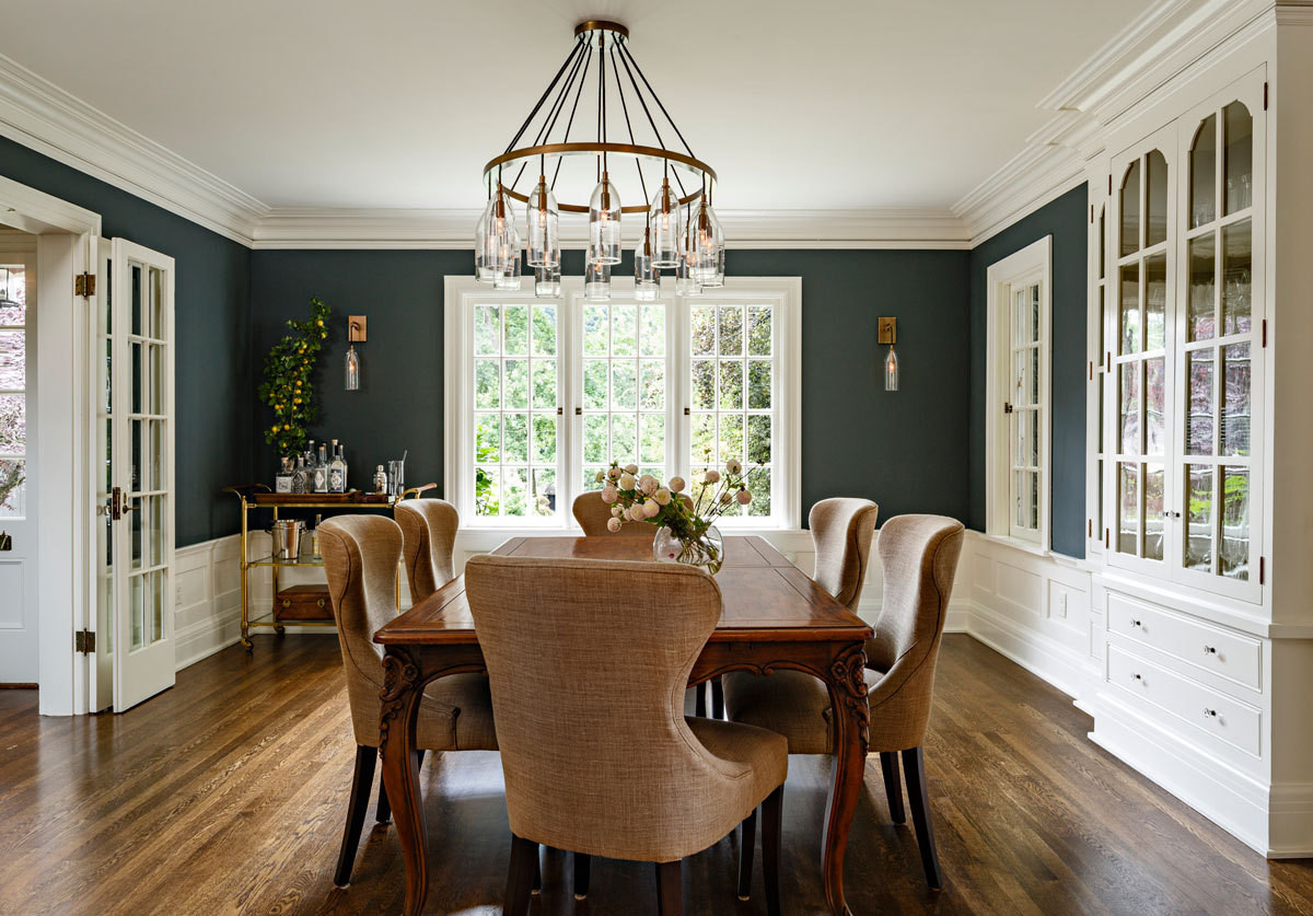Walls in Benjamin Moore's Dark Pewter highlight the built-in china hutch added by Helgerson.
