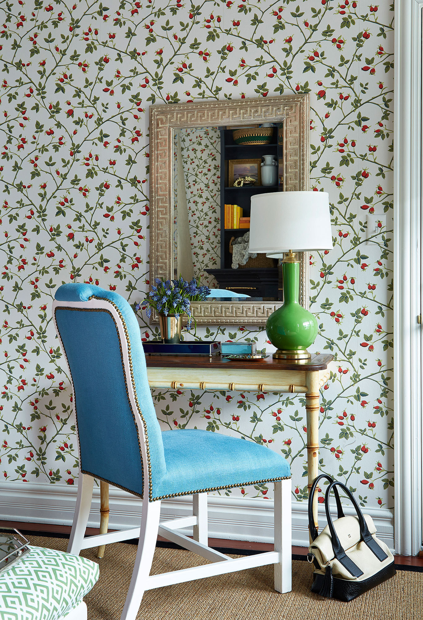 For a touch of high-low mix, Thornton paired a hand-carved mirror from Ballard Designs with a classic armchair by Bunny Williams.