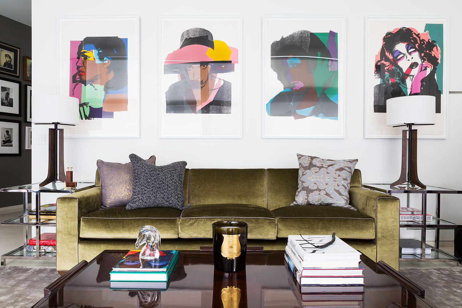 Andy Warhol prints are displayed above a velvet sofa in Kent Belden and Dr. Louis Re's Manhattan living room.