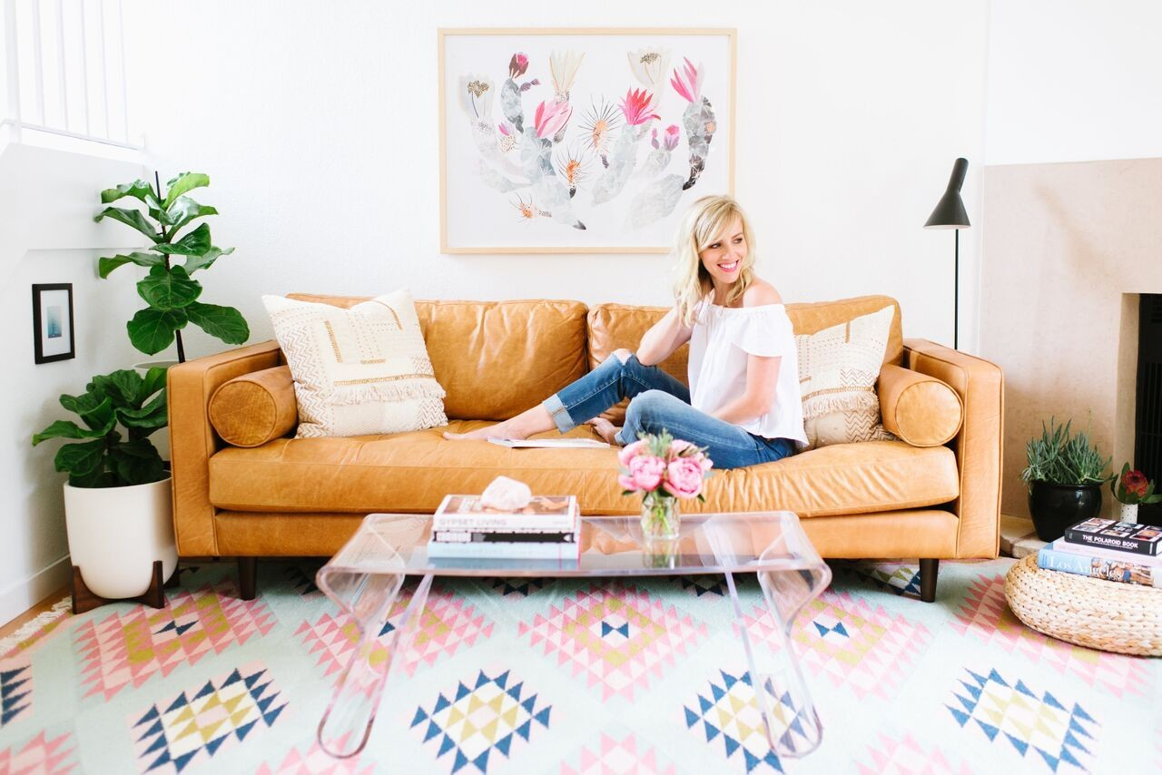 Glitter Guide founder Taylor Sterling at home in California with The Elodie Rug. Photo by Delbarr Moradi for Lulu & Georgia.