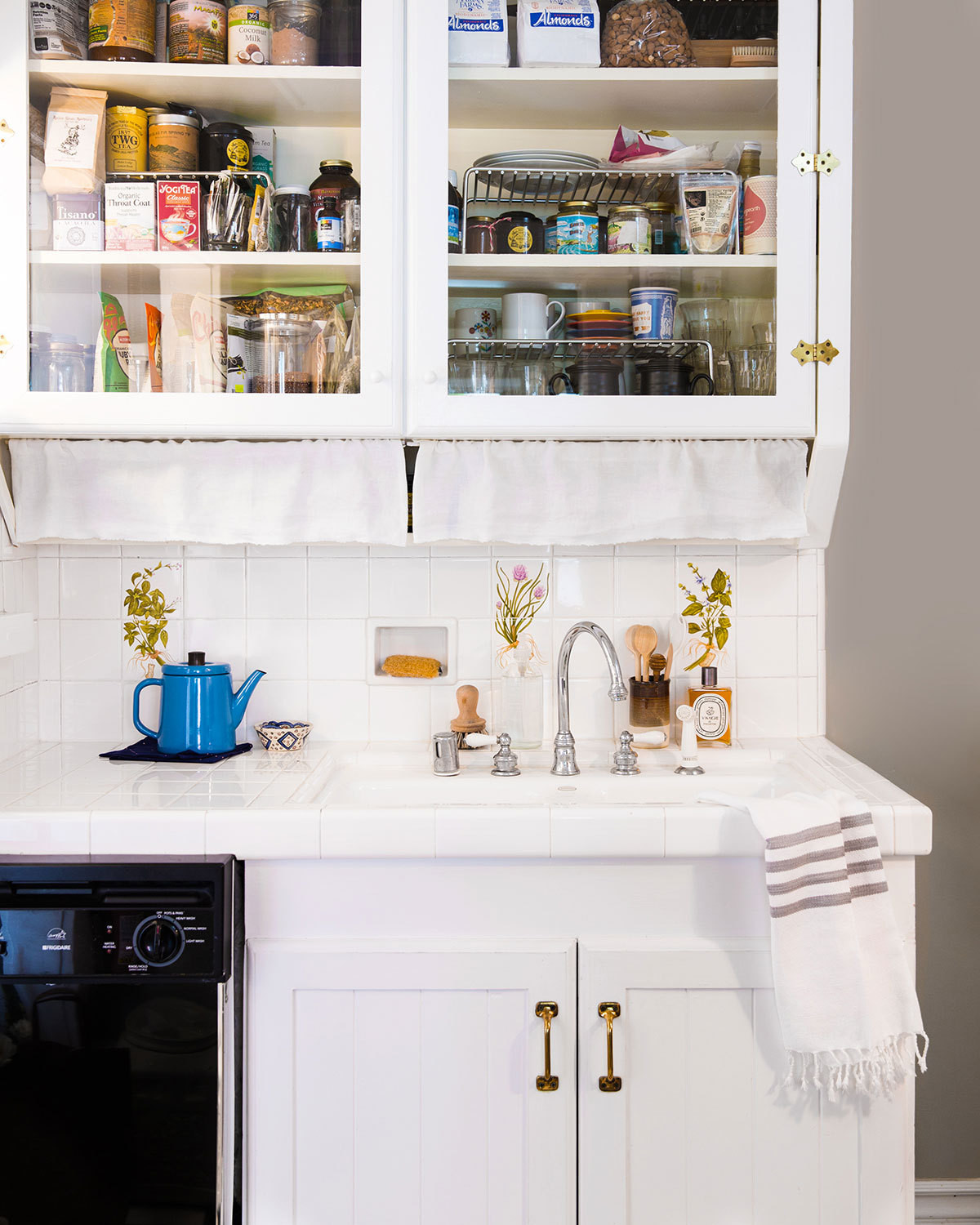 A petite yet pretty kitchen is just right for a two-person household.