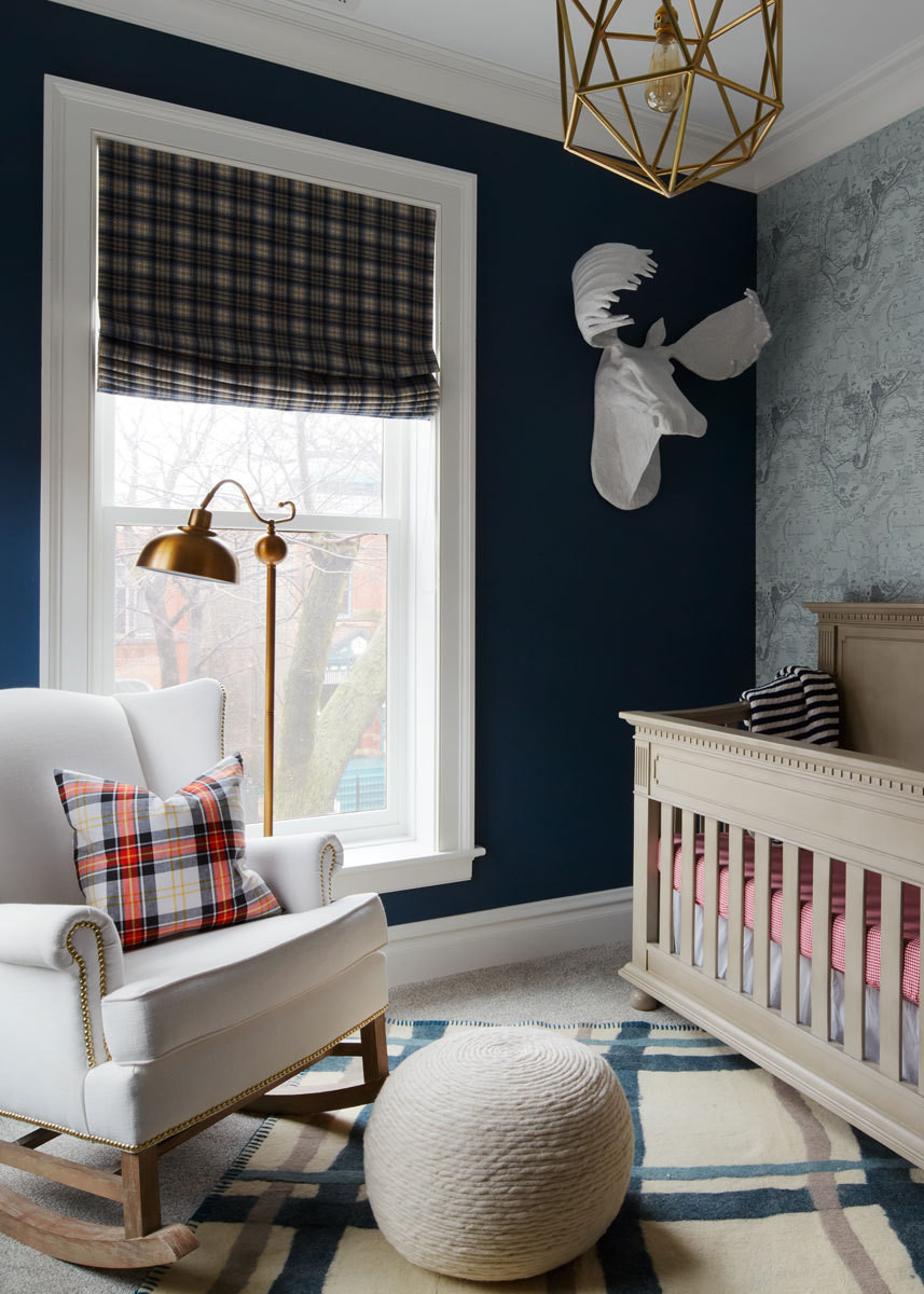 Jonas' gentlemanly nursery, with its navy walls and tartan window treatments, was inspired by a cigar bar.
