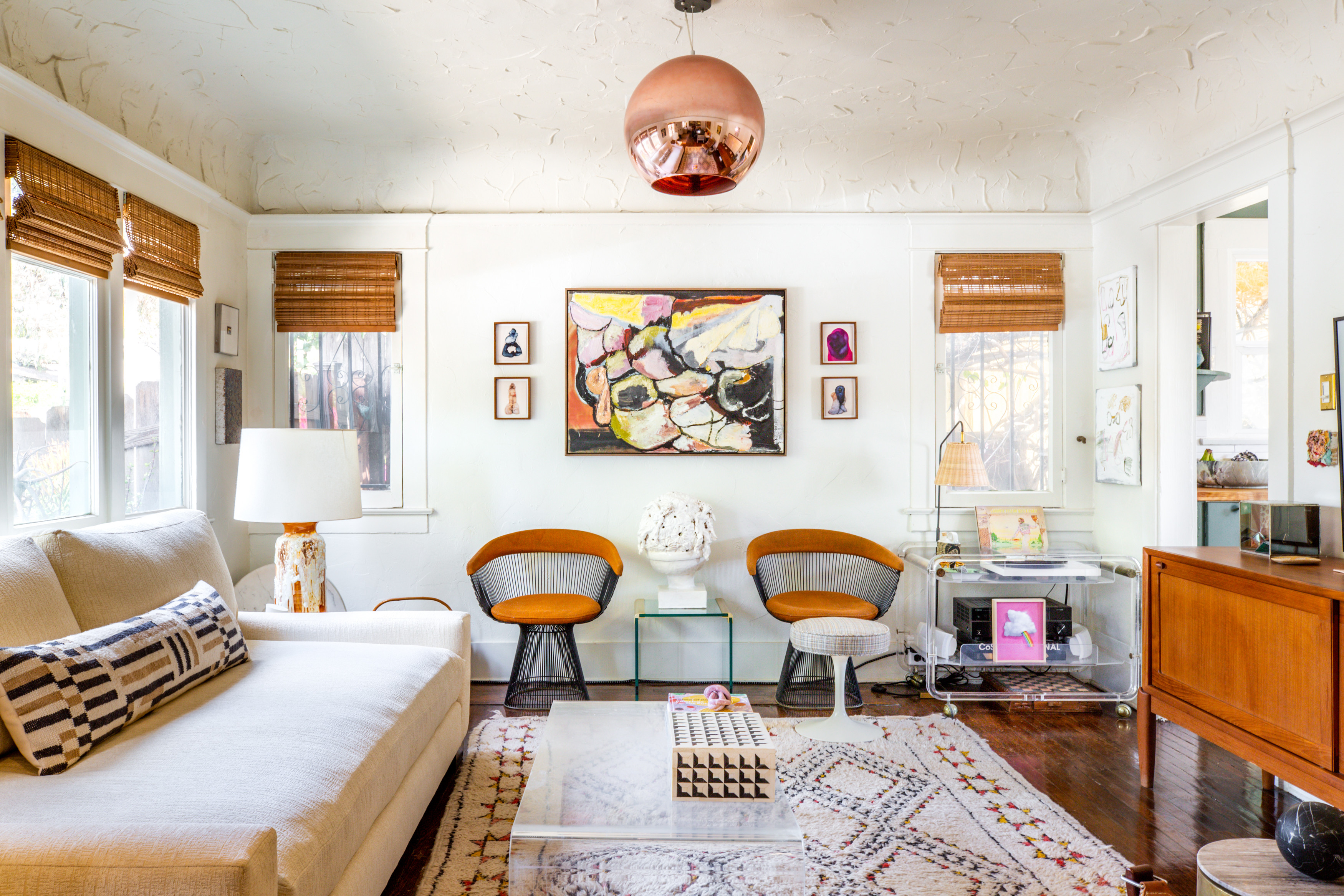 Molofsky opted for a neutral foundation in the living room, injecting a maximalist vibe through pattern and texture.The Joneses LA Custom Sofa |Parchute Pillow |Warren Platner Armchairs |Robert Gunderman Painting |Polly Borland Photographs |Vintage Lucite Coffee Table|Serena & Lily Floor Lamp |Samsung Frame TV