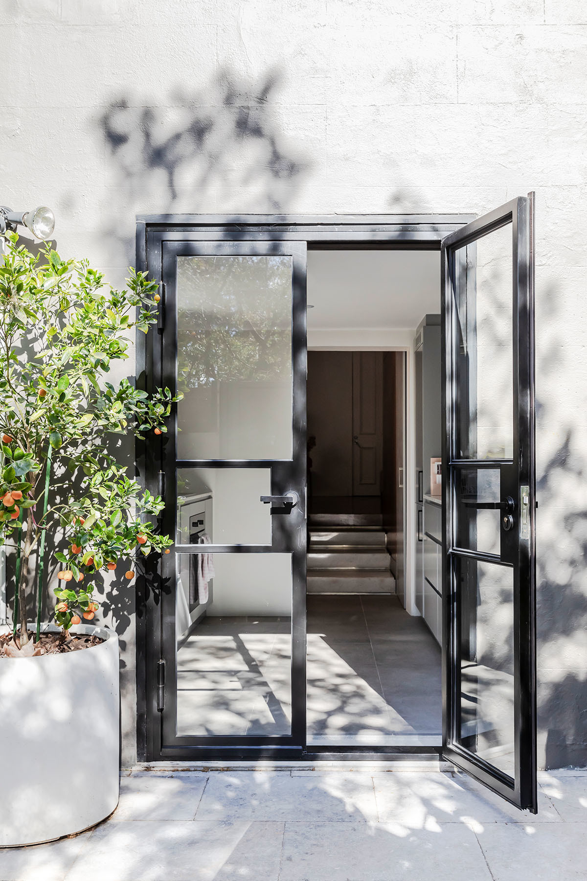 "A leafy and ultimately ""low-maintenance"" courtyard adheres to the Sydney vibe."